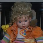 Possessed blue-eyed doll wanders house at night and scratches children as they sleep in family's 'living nightmare
